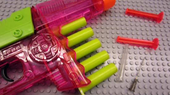 A plastic dart gun